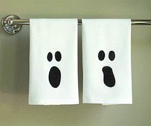 Cool & Creepy Halloween Decorations: Ghostly Tea Towels (via Parents.com).. TOO CUTE .. and HOW easy!