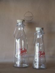Glass storage bottles with ceramic stoppers printed with the English TALA brand.