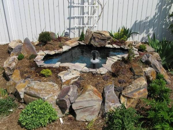 How to build a raised pond backyard gardening blog my for Garden pond stones