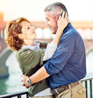 Romantic middle aged couple outdoors. With Granny and Grandpa.