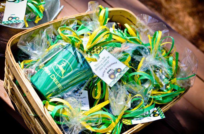 Tractor Party Favors:  John Deere plastic cups, John Deere popcorn bags, small plastic farm animals, John Deere sippy cups
