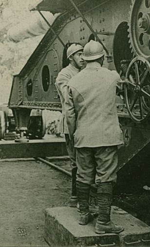 WWI, c 1916; French gunners adjusting a large rail-mounted artillery piece. Part of a stereoscopic image. - Getty/Hulton