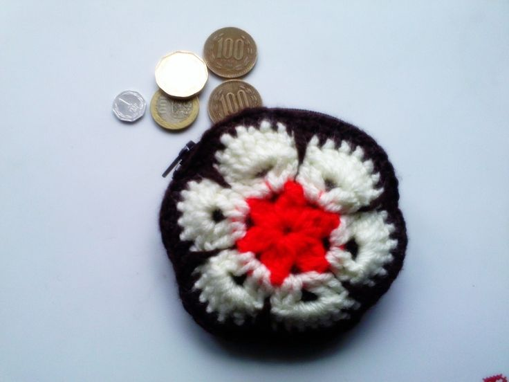 Monedero flor africana
