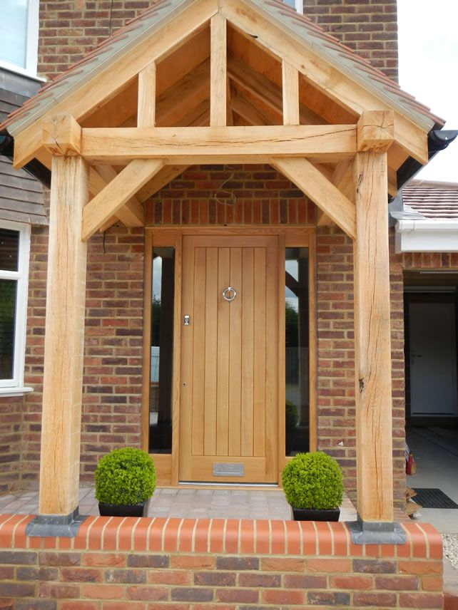 An oak front door with oak porch