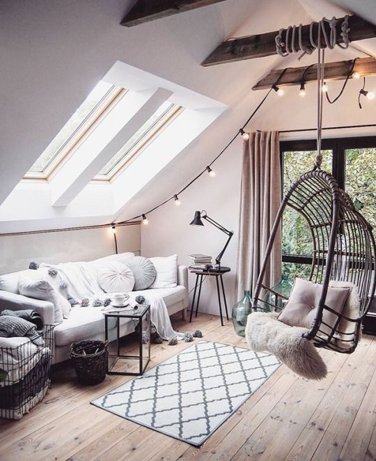 White wall rooftop room with cosy sofa and cushions | That swing swinging from the ceiling tho