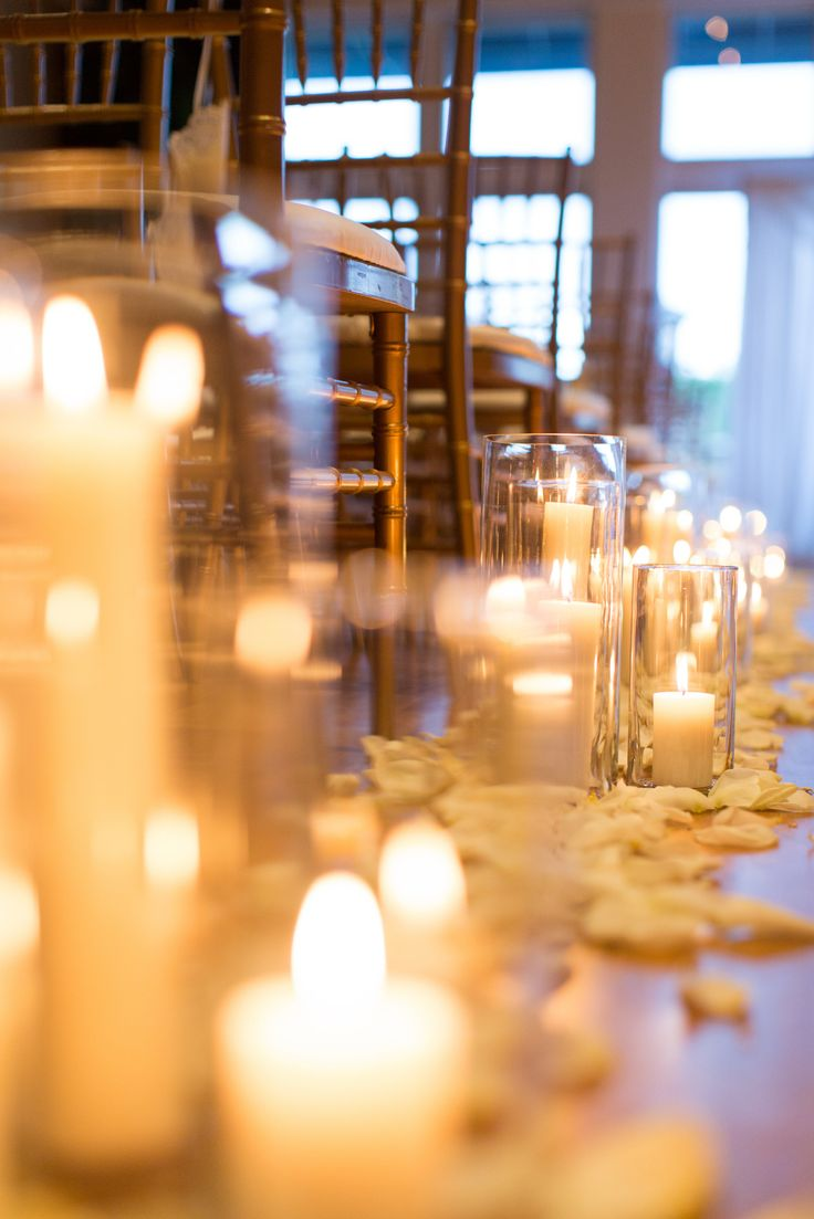 Hurricane Vases Down The Aisle Candles Lining The Aisle