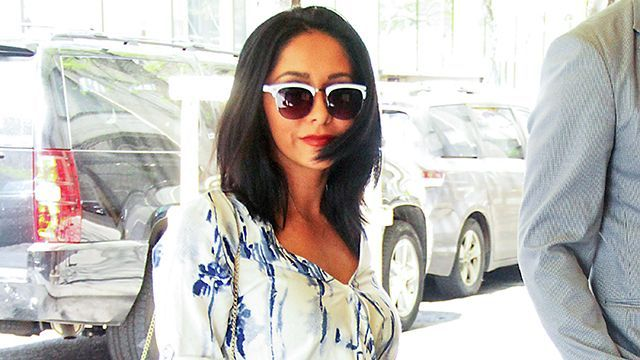 "Daaang, girl! Former Jersey Shore star Nicole ""Snooki"" Polizzi was spotted in New York City on Thursday, looking almost unrecognizable from the girl we used to know on the beloved MTV reality program. Showing some leg in a flattering blue-and-white romper, the 27-year-old reality star accessorized with chic nude heels, a waist-accentuating bow belt, and a trendy fringe bag. Splash News PHOTOS: Snooki's Incredible Post- Jersey Shore Transformation Can we also point out how fabulous her dark…"