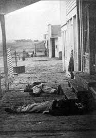 After a gunfight in a Hays, Kansas, saloon in 1873, two soldiers lie dead.