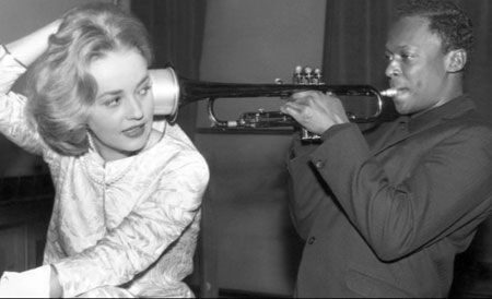 "Jeanne Moreau and Miles Davis, on the set of the film, ""Ascenseur a l'echafaud"" or ""Lift to the Scaffold,"" for which Miles Davis wrote and performed the score."