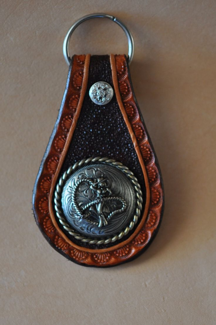 Roping Cowgirl Hand tooled leather key fob, key chain.. $14.99, via Etsy.
