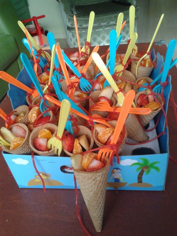 Fun beach world treat made made from fruit and strawberry laces.