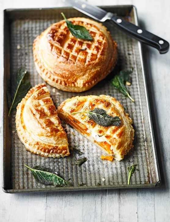 This take on a puff pastry pie is a smart individual vegetarian main course for a dinner party, or as a special family lunch. Layers of butternut squash mean that once cut open this French-style dish looks as good on the inside as it does on the outside with its decorative top. Serve with a green salad or seasonal veg.