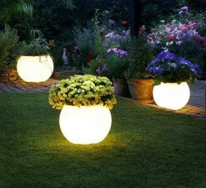 Great Idea! Flower pots painted with Rustoleum's glow in the dark paint. They soak up the energy during the day light and brighten up your yard at night