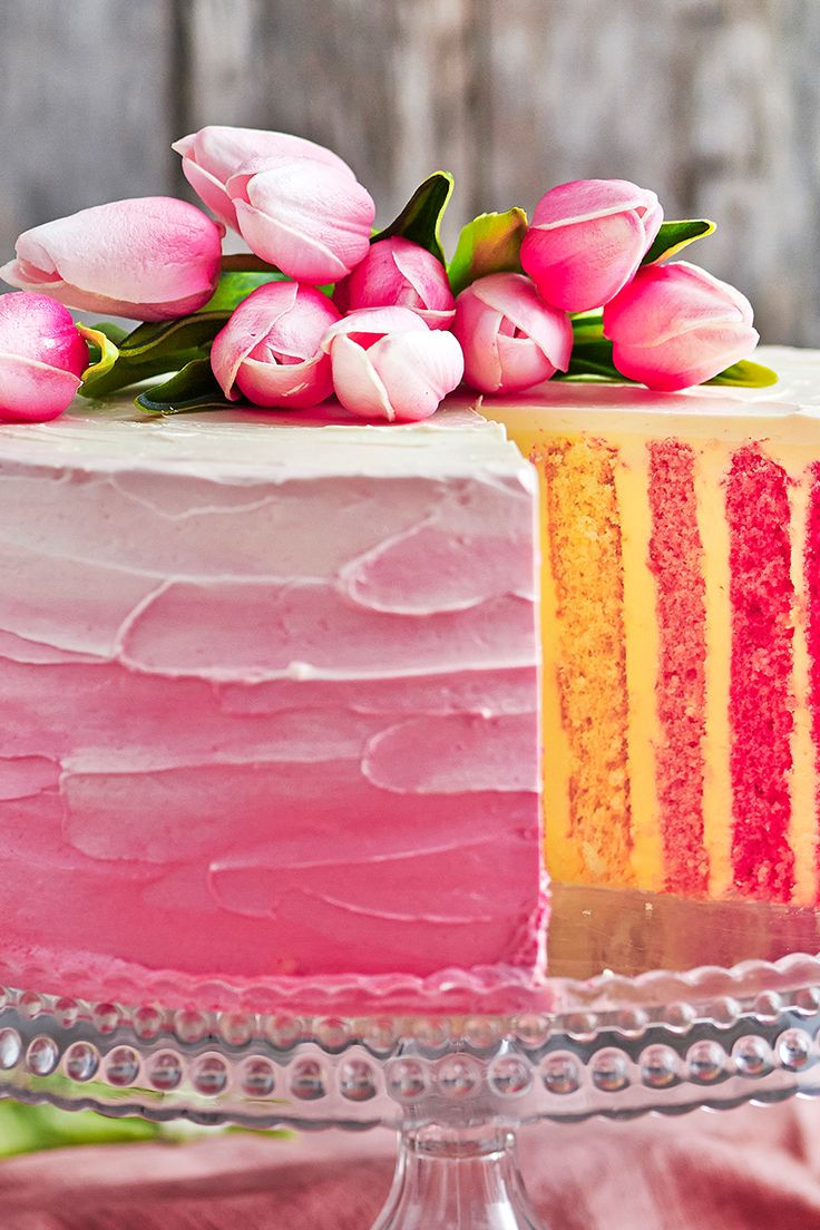 This vibrant rose pink vertical stripe cake is full of colour and delicious, sweet flavour - the perfect cake for your next party, family gathering, or celebration!