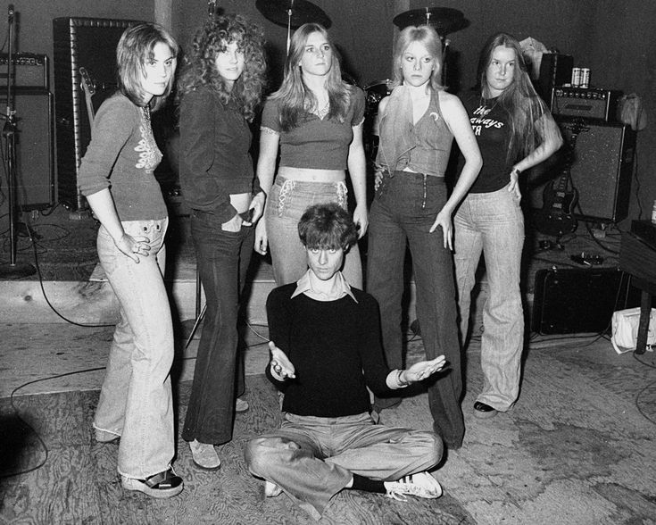 The 1975 Runaways lineup; Joan Jett, Peggy Foster(?), Sandy West, Cherie Currie and Lita Ford with Kim Fowley
