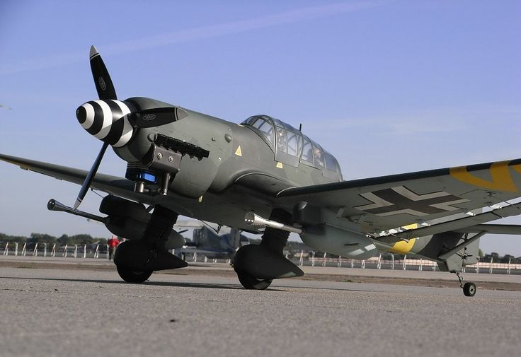 "Junkers Ju 87 or Stuka (from Sturzkampfflugzeug, ""dive bomber"") was a two-man (pilot and rear gunner) German dive bomber and ground-attack aircraft. First flight 1936."