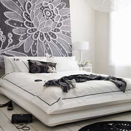 get a huge piece of plywood, and cover it in awesome fabric !!!! then twinkle lights above the bed