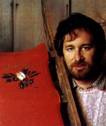 """Rosebud Sled--Steven-Spielberg-Holding-Rosebud-Sled at auction for $60,500 in 1982 from the movie """"Citizen Kane""""."""