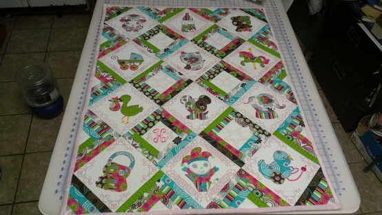 quilt for baby girl with the help of anita goodesign