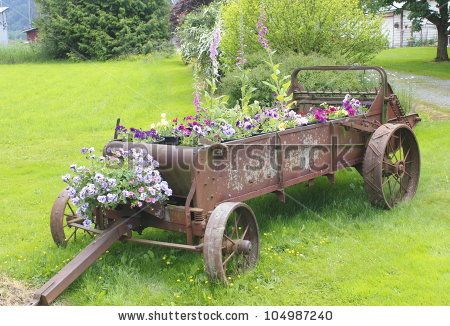 landscaping with old farm equipment | Old farm machinery is used to create a colorful planter/Old Time ...