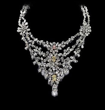 181 carats, De Beers -Marie Antoinette Necklace  The main diamonds which dominate the uniqueness of Marie Antoinette Necklace are in the front with leading pink color diamond at the top and 2 yellow diamonds below it directly. The Marie Antoinette Necklace is at 9th in the list of Top 10 Most Expensive Jewelry and is currently priced at over Three point Seven Million.