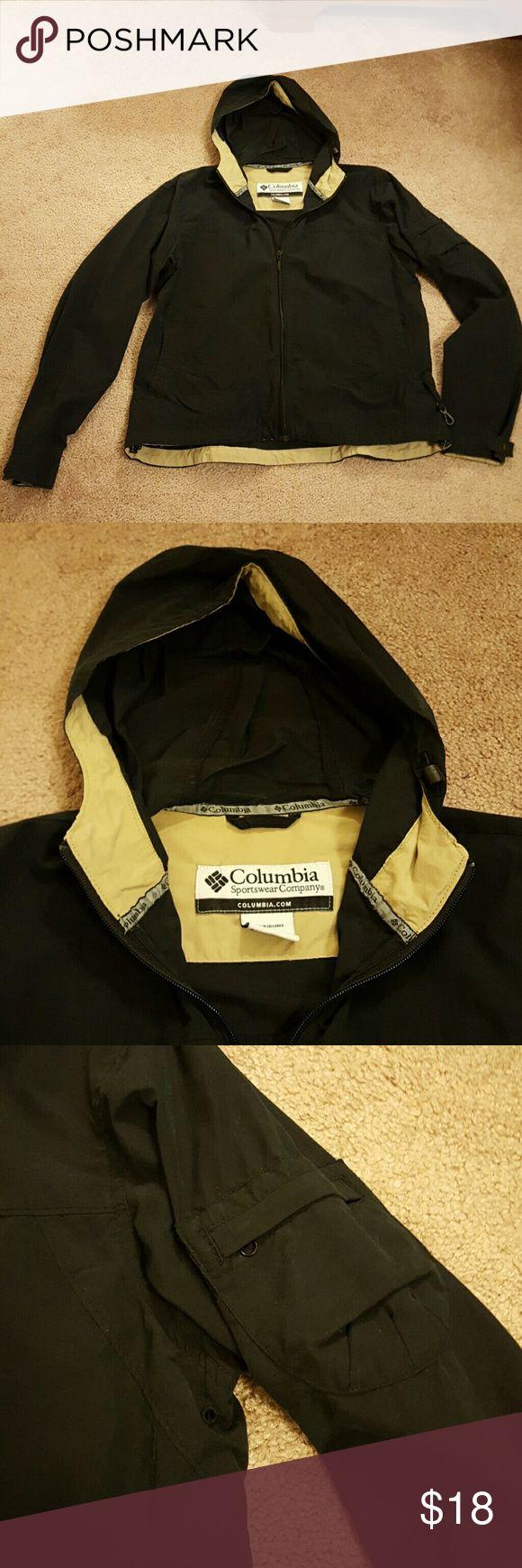 Columbia hooded jacket Columbia Sportswear Company hooded jacket. Drawstring at waist, snap cuffs, zippered pocket on sleeve. Like new! Columbia Jackets & Coats Utility Jackets
