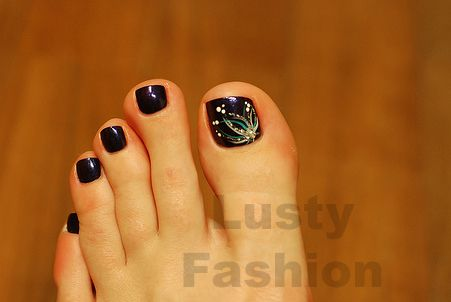 toe nail art design 1. Design on big toe, solid color on the rest