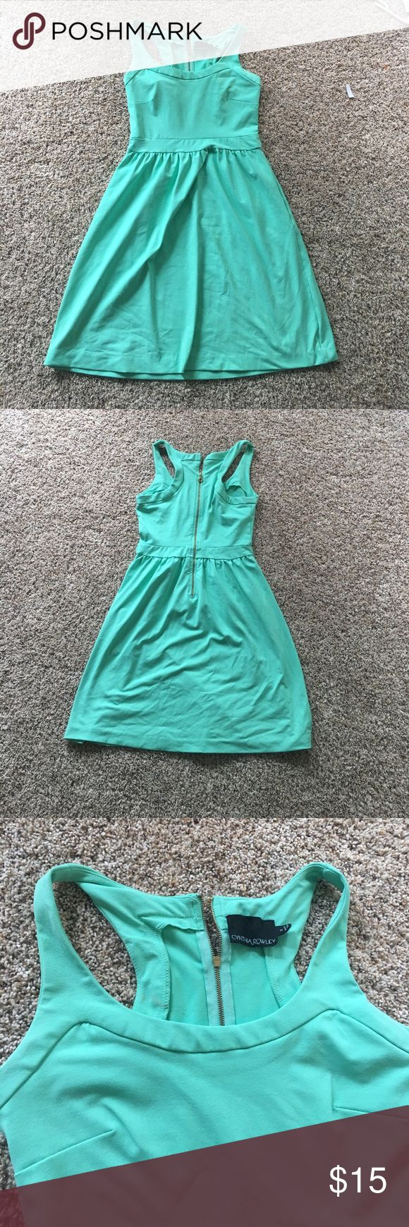 Women's dress Women's mint green scuba dress. Fabric is very stretchy. HAS POCKETS! Razorback. Brand is Cynthia Rowley. No padding on the chest. Size small! Zipper on the back! So cute! Just not my style for going out!! Cynthia Rowley Dresses