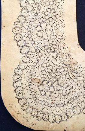 Pinpricks show a used bobbin lace pattern dated 1788