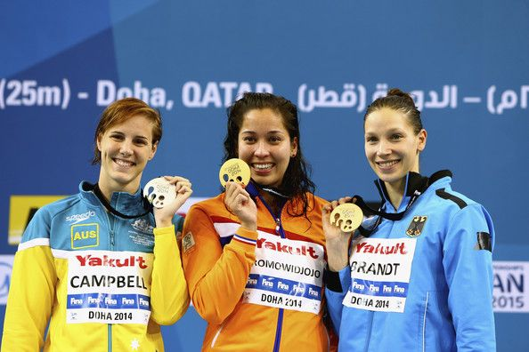 Bronte Campbell of Australia, Ranomi Kromowidjojo of the Netherlands and Dorothea Brandt of Germany celebrates on the podium after the Women's 50m Freestyle Final