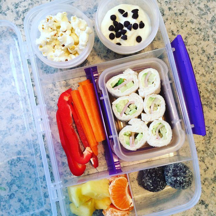 Lunch box ideas : Home popped popcorn  Greek yoghurt &a dark chocolate chips  Carrot sticks  Red capsicum  Pineapple  Mandarin  Chocolate coconut bliss balls  Sandwich sushi