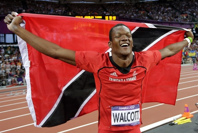 Trinidad's Keshorn Walcott celebrates winning gold in the men's javelin throw final during the athletics in the Olympic Stadium.