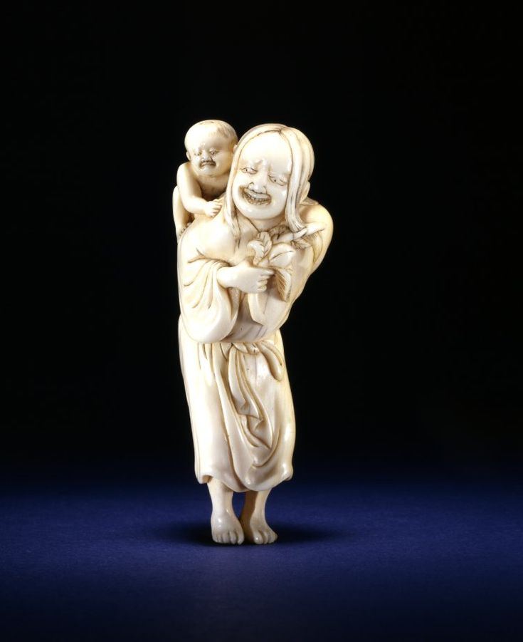 This netsuke depicts baby Momotaro carried by his foster mother.