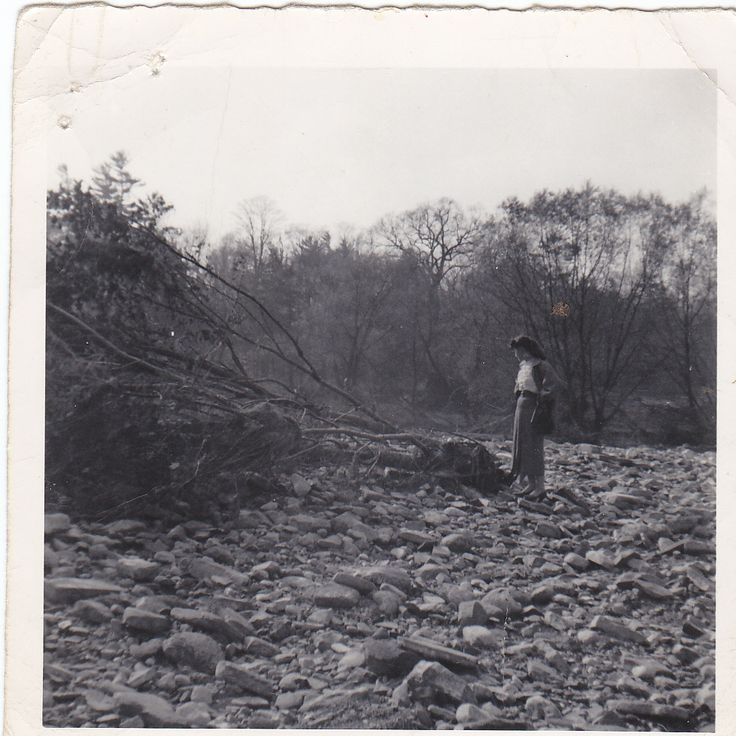 A woman standing where her home was after hurricane Hazel