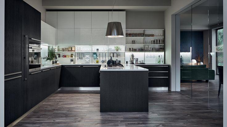 EXTRA - Il legno come elemento caratterizzante di un progetto che interpreta gli orientamenti più avanzati della contemporaneità senza rinunciare alla naturalità. Dedicato ai palati più raffinati l'accostamento tra le essenze e i laccati opachi e lucidi.
