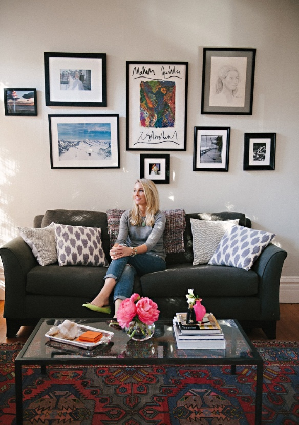 Meg Galligan Home Tour // living room // ikat pillows // gallery wall // eclectic rug // grey // coffee table styling // photography by Andi Hatch // styling by Meg Galligan