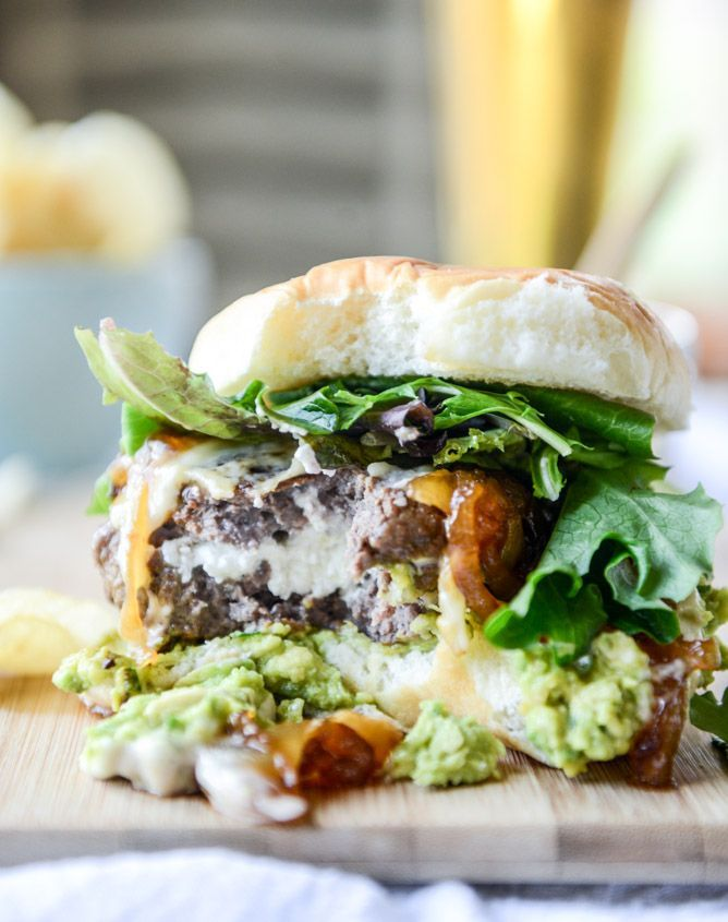 goat cheese guac burgers with cheddar and caramelized onions