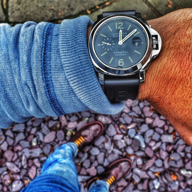"""Panerai Luminor Marina PAM00104. Original M series from 2011. Fully polished stainless steel case and bezel - diameter of 44mm (excluding the crown). Water resistant to 300 meters. Black """"L SWISS MADE L"""" dial with Superluminova hour markers and hands. Sweeping seconds hand located at the 3 o'clock position. Panerai Automatic movement - OPIII. Panerai rubber dive strap with polished Panerai folding buckle - also includes an unworn Panerai brown croc strap - other strap options are available…"""