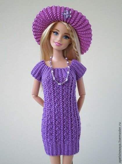 Achei estes vestidos lindos de bonecas no Facebook عالم الكروشية . Só não achei o gráfico .
