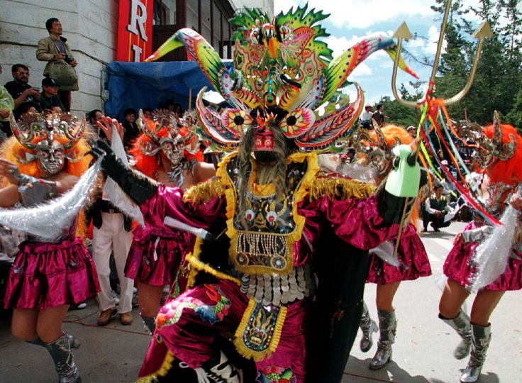 dANCERS WITH DEVILS' MASKS AT THE bOLIVIAN cARNAVAL, a tradition of many years, representing the evil spirits of the tin mines in Bolivia.