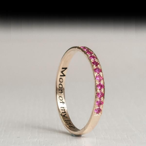 Gold half eternity ring traditionally set with 1.5mm Pink Ruby Gemstones The stones are Beautifully round Cut Facet , Color Rich with a Crimson Shimmer.This par