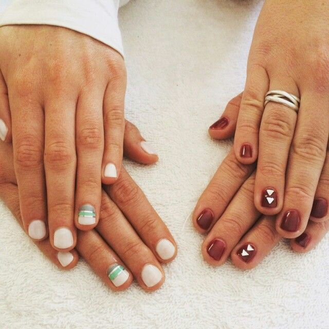 Besties who visited for a manicure. Left is all white with a statement nail, done with green & grey and a silver lining. Right is Burgundy with silver triangular nail art. #SnowAngel #Burgundy #Tranquility #nailart #nailswag #mani #PolishPro