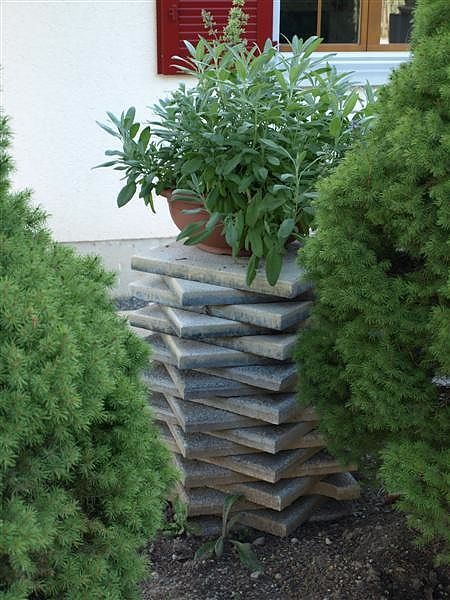 interesting idea to add height and texture using surplus stacked concrete tiles - Concrete Tile Garden Decor