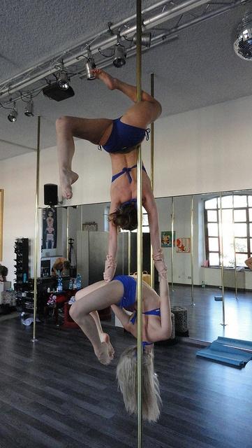 Crazy partner pole trick