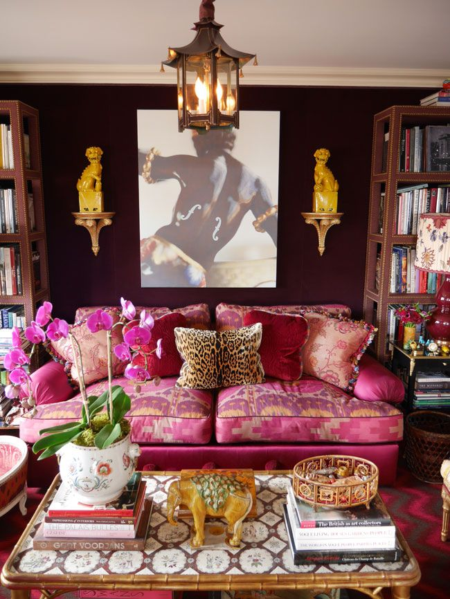 Alex PapachristidisSo many Chinoiserie favorites here - foo dogs, an elephant, a pagoda lantern, an orchid, a double gourd lamp, and a gilded faux bamboo coffee table. I love the aubergine walls, pink