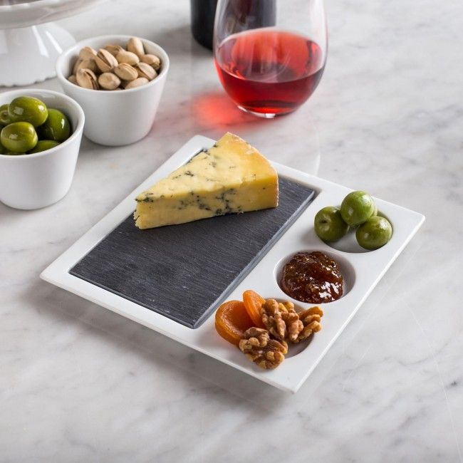 deal for individual appetizer parings of cheese or meats. The porcelain plates 3 recesses are ideal for holding dips, compotes, jellies or preserves. The inset grey slate tray elegantly contrasts the simple white porcelain to provide a stylish serving dish for cocktail parties or casual get-togethers.