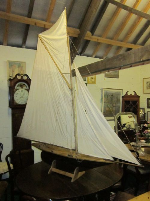 "An antique pond yacht of huge proportions. 66"" (168cm.) long. 86"" (219cm.) high. inc. stand. 11"" (28cm.) wide."