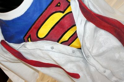 Hand painted, cotton fabric men's t-shirt, using non-toxic, water based, permanent fabric colors.| For a Superman in disguise!