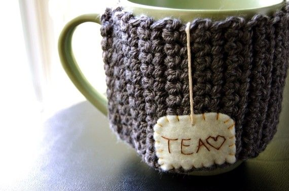 """Size: This will fit most average sized mugs (4"" tall, and 10.5"" around) snugly. This cozy is flexible, and will slip right onto your mug, with an opening where the mug handle fits through. ♥ This and all of my mug cozies are original KnitStorm designs"""