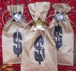 "Cowboy party  Loot bags are a must. Simply print dollar signs on paper bags, fill them with ""loot"", and tie with a piece of rafia."